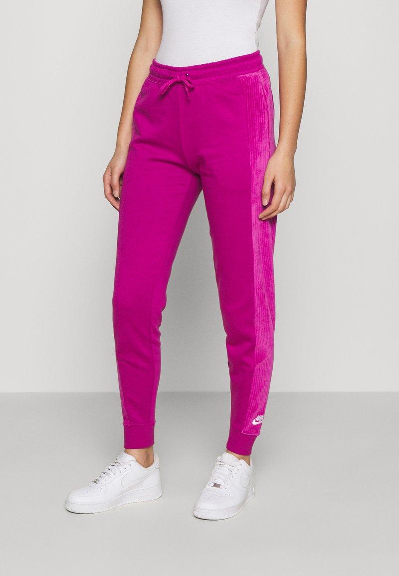 Nike Sportswear - HRTG VELOUR - Tracksuit bottoms - cactus flower
