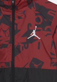 Jordan - UNISEX - Windbreaker - gym red - 2