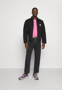 Carhartt WIP - NEWEL PANT MAITLAND - Relaxed fit jeans - black stone washed - 1