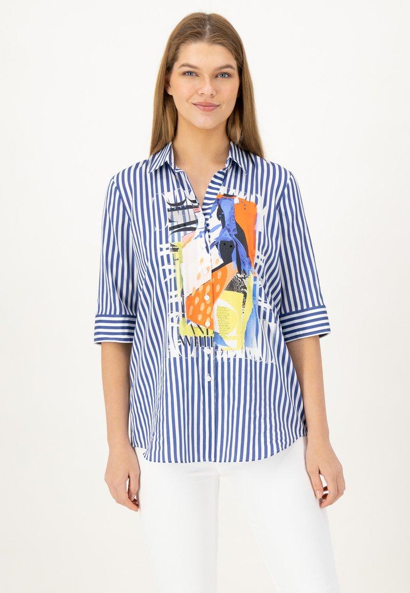JUST WHITE - Button-down blouse - indigo streifen