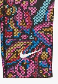 Nike Performance - ALL IN CAPRI FEMME - 3/4 sports trousers - black/white - 3
