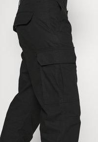 Dickies - MILLERVILLE - Cargo trousers - black - 5