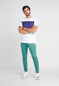 Nike Performance - DRY PANT  - Tracksuit bottoms - bicoastal/white - 1