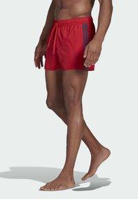 adidas Performance - CLASSIC 3-STRIPES SWIM SHORTS - Swimming shorts - red - 2
