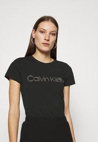 Calvin Klein - SLIM FIT METALLIC LOGO TEE - Print T-shirt - black - 0