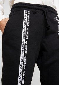 adidas Originals - R.Y.V. CUFFED SPORT PANTS - Verryttelyhousut - black - 4