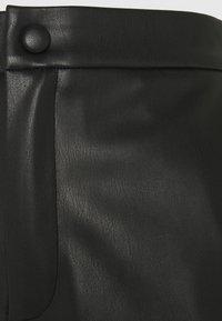 Modström - HILAL PANTS - Trousers - black - 2