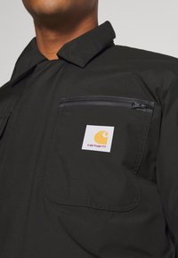 Carhartt WIP - GORE TEX MICHIGAN COAT - Light jacket - black - 6