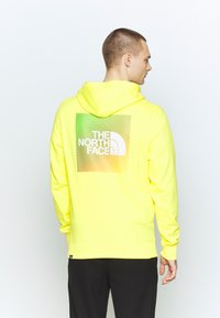 The North Face - GRAPHIC HOODIE - Mikina skapucí - lemon/white - 2