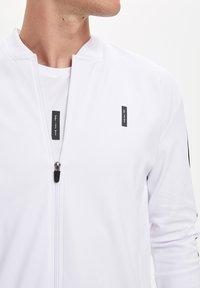 DeFacto Fit - Zip-up hoodie - white - 4