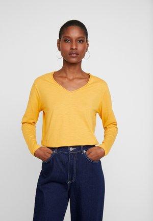 BABETTE - Jersey de punto - honey yellow