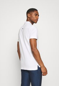 Tommy Hilfiger - CONTRAST PLACKET SLIM  - Polo shirt - white - 2