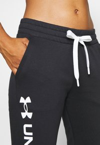 Under Armour - RIVAL SHINE JOGGER - Tracksuit bottoms - black - 5