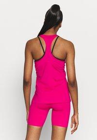 Nike Performance - TANK ALL OVER  - T-shirt sportiva - fireberry/white - 2