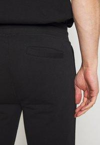 Bricktown - PANTS CIGARETTE - Tracksuit bottoms - black - 3