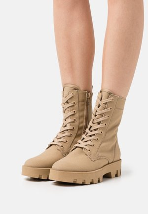 PILAR - Lace-up ankle boots - dune