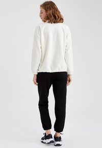 DeFacto Fit - Pantalones deportivos - black - 2