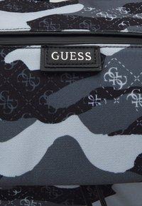 Guess - SALAMEDA SMART CAMOUFLAGE BACKPACK - Rucksack - black - 5