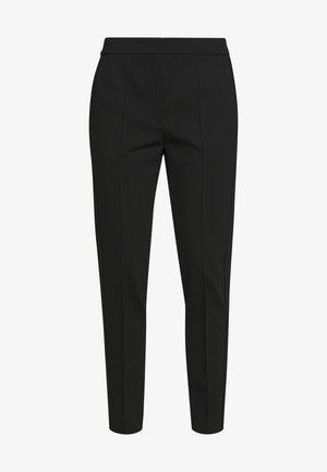 TUNTA - Pantaloni - black