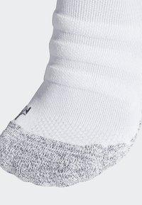 adidas Performance - ALPHASKIN TRAXION LIGHTWEIGHT CUSHIONING CREW SOCKS - Sports socks - white - 1