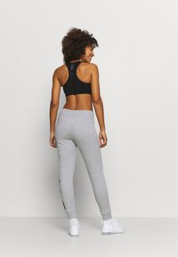 DKNY - EXPLODED LOGO CUFFED - Tracksuit bottoms - pearl grey heather - 2