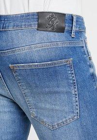 Gym King - SALVATION PAINT SPLATTER - Jeans Skinny Fit - mid blue - 4