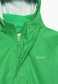 CeLaVi - BASIC RAINWEAR SUIT SOLID - Regnbukser - green - 8