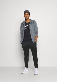 Nike Performance - PANT CAPRA - Tracksuit bottoms - black/iron grey - 1