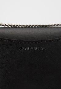 Calvin Klein Jeans - MEDIUM FLAP CHAIN - Across body bag - black - 2