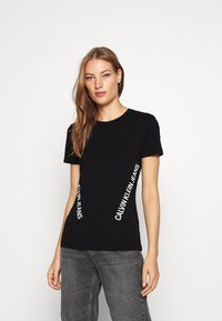 Calvin Klein Jeans - INNOVATION TEE - T-shirt con stampa - black - 0