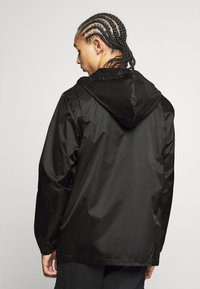 Reebok Classic - VECTOR WINDBREAKER - Summer jacket - black - 2