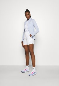 Nike Golf - DRY FIT VICTORY SHORT - Sports shorts - white - 1