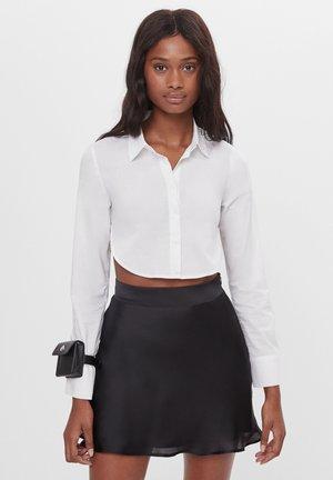 SATIN - Áčková sukně - black