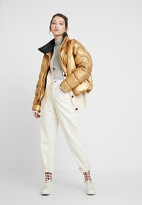 Nike Sportswear - FILL SHINE - Winter jacket - metallic gold/black