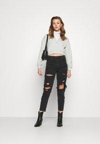 American Eagle - Slim fit jeans - destroyed black - 1