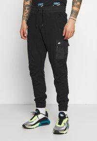 Nike Sportswear - ME PANT - Cargo trousers - black - 0