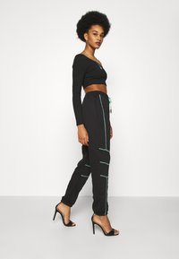 Missguided - PLAYBOY CONTRAST STITCH - Pantalones deportivos - black - 3