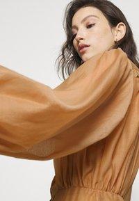 Missguided - PREMIUM BALLOON SLEEVE FRILL HEM MINI - Day dress - beige - 3
