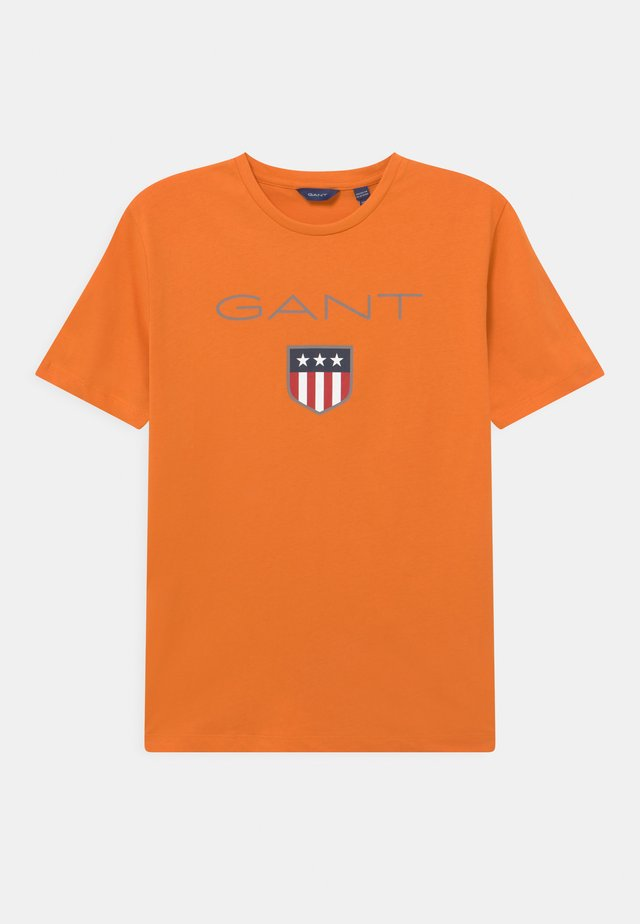 SHIELD LOGO UNISEX - Print T-shirt - russet orange