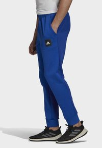 adidas Performance - MUST HAVES STADIUM TRACKSUIT BOTTOMS - Pantalones - blue - 2