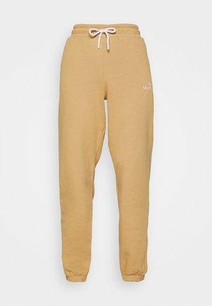 PAMA - Spodnie treningowe - beige
