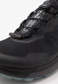 Salomon - SENSE RIDE 3 - Trail running shoes - black/ebony/lead - 5