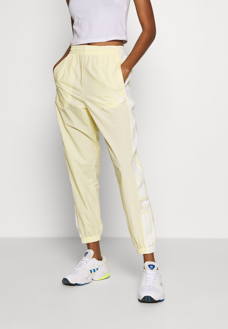 adidas Originals - LOCK UP ADICOLOR NYLON TRACK PANTS - Tracksuit bottoms - easy yellow/white