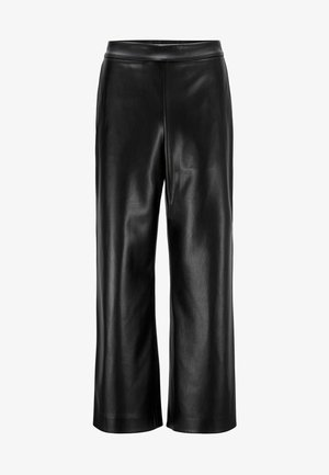 TAOMIE - Leather trousers - black