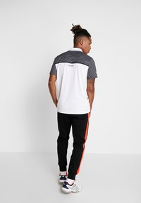 Lacoste Sport - DH4776  - Sports shirt - white/black - 2