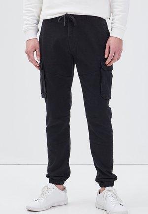 MIT TUNNELZUG IN DER TAILLE - Cargo trousers - noir