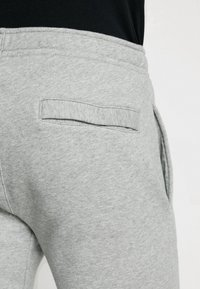 Nike Sportswear - CLUB CUFFED PANT - Tracksuit bottoms - dark grey heather/white - 3
