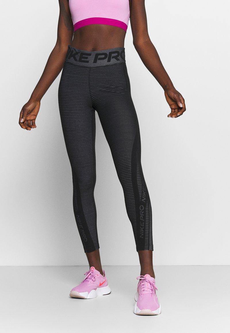 Nike Performance - Leggings - black/white/metallic silver