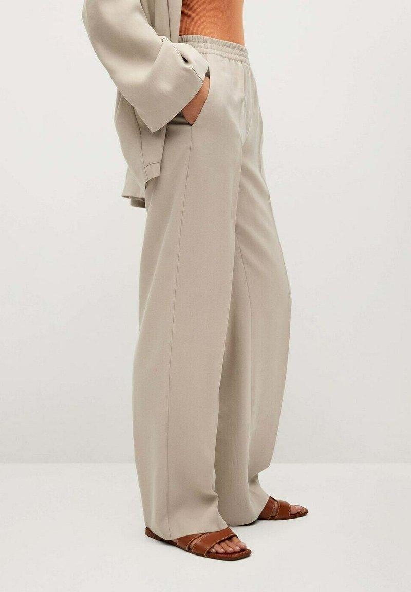 Mango - FLOWY STRAIGHT-FIT  - Trousers - ecru