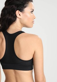 Casall - ICONIC SPORTS BRA - Medium support sports bra - black - 3